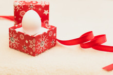 Happy New Year / Marry Christmas White Egg In Red Box On White Background And Red Ribbon Reminds Heart