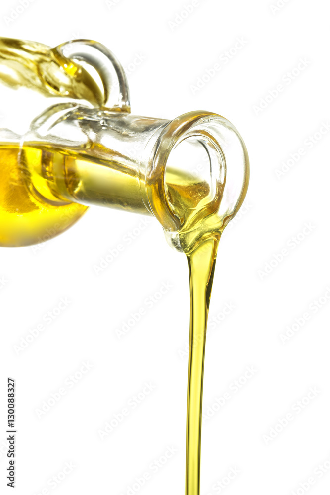 Fototapety, obrazy: glass bottle pouring oil isolated on white