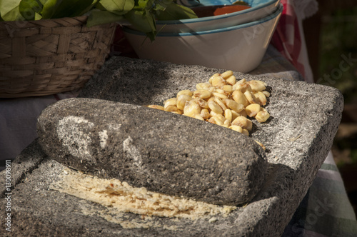 Fotografie, Obraz  Old Fashioned Grinding of Corn for Tortilla