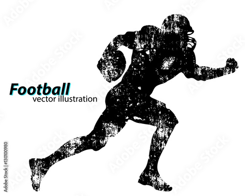 Fotografija silhouette of a football player. Rugby. American footballer