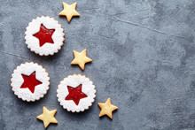 Linzer Star Cookies With Berry Jam Filling Traditional Christmas Baked Homemade Austrian Sweet Dessert Food Xmas Celebration Pastry Powdered Holiday Snack On Vintage Table Background. Flat Lay