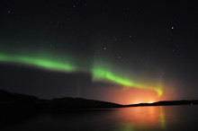Northern Lights And Stars On S...