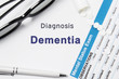 Diagnosis of Dementia. Results of mental status exam, container with crumbled pills with inscription psychiatric diagnosis Dementia on white background or white workplace psychiatrist or psychologist