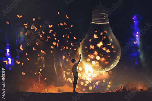 Photo  man and big bulb with glowing butterflies inside,illustration painting