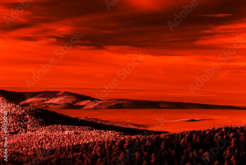 Fantastic aerial infrared view of mountain landscape with sea of