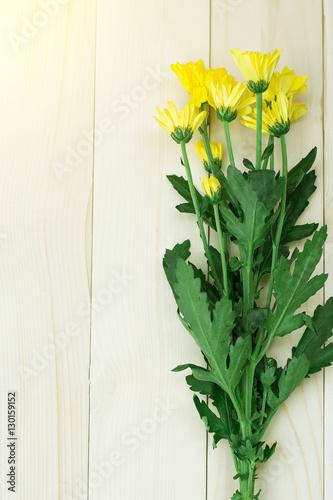 Poster Muguet de mai chrysanthemum yellow on background wood and soft light