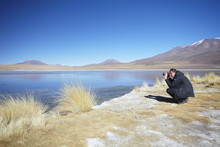Man Taking Photos At Laguna Ca...