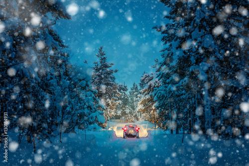 Zdjęcie XXL Winter Driving at snowfall night - Światła samochodu w zaśnieżonej drodze