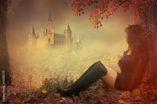 Fotografie, Obraz  photomontage fantaisie d' une femme assise devant un château