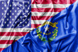 Ruffled waving United States of America and Nevada flag