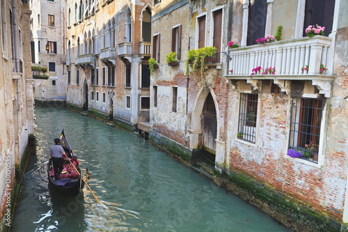 A gondola on a canal in Venice, UNESCO World Heritage Site. Veneto, Italy, Europe