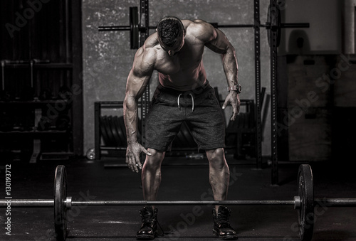 Fotografie, Tablou  Muscle Man about to Pickup Barbell
