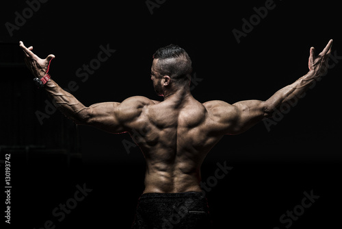 Photo  Man showing muscular Back