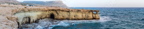 Panorama of sea caves and Mediterranean at sunset. Cape Greko, Cyprus.