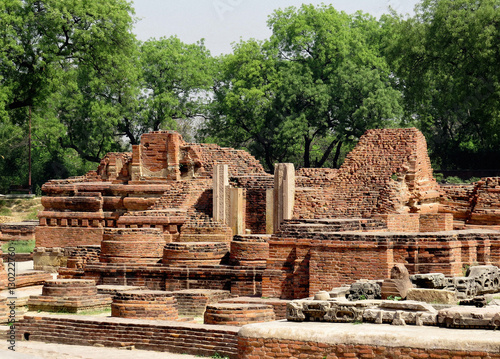 Staande foto Rudnes Ruins of ancient buildings, temple and Buddhist stupas of the ancient city of Sarnath - the place of the Buddha's first sermon near Benares, India