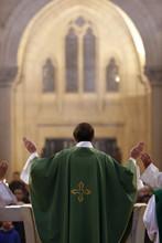 Eucharist, Priest In Catholic Mass, Notre-Dame Du Perpetuel Secours Basilica, Paris, France