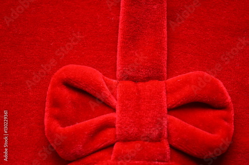 Beautiful Bright Red Velvet Background With Luxurious Bow Cloth