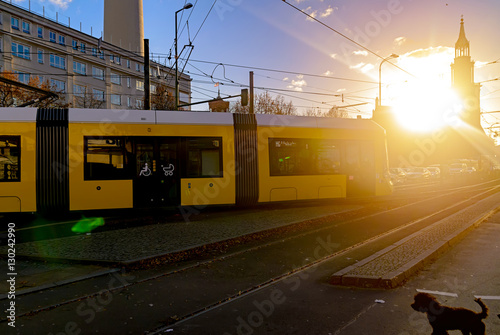 Leinwand Poster  Modern electric tram yellow color on the streets of Berlin