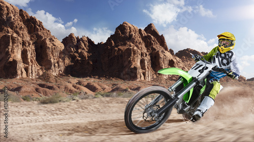Professional dirt bike rider racing on the desert