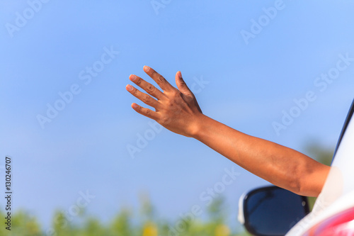 Fotografie, Tablou  Vacation and travel concept, Male arm sticking out of the car