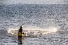 Man Netfishing In The Harbour Of Apia, Upolu, Samoa, South Pacific