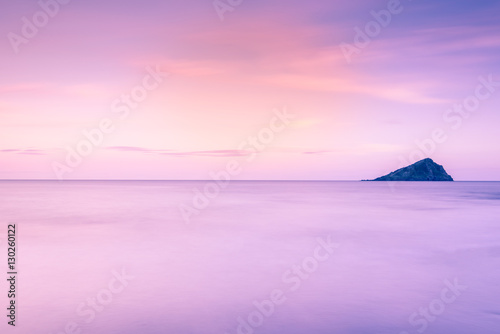 Wall Murals Light pink lonely island at sunset