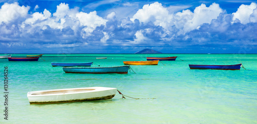 old rustic fishermen' boats in turquoise sea Canvas Print