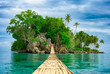 canvas print picture - Bamboo hanging bridge over sea to tropical island