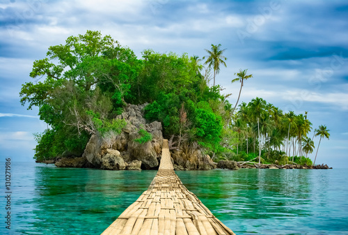 Poster Island Bamboo hanging bridge over sea to tropical island