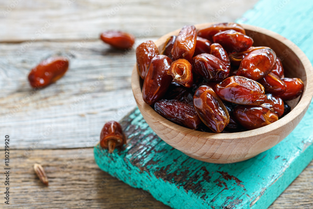 Fototapety, obrazy: Bowl with delicious dried dates.