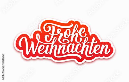 Frohe Weihnachten Deutsch Text On Paper Label With Hand