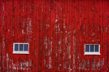 Red Barn Wall With Windows And Aged Red Paint Peeling Off Boards
