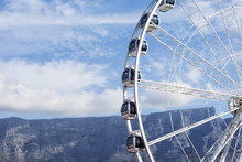 Ferris Wheel With Table Mountain In Distance, Victoria And Alfred Waterfront, Cape Town