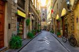 Fototapeta Uliczki - Narrow cozy street in Florence, Tuscany. Italy