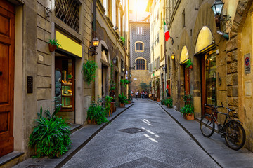 Fototapeta Narrow cozy street in Florence, Tuscany. Italy