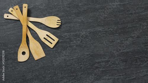 Valokuva  Set of wooden kitchen utensils on marble background