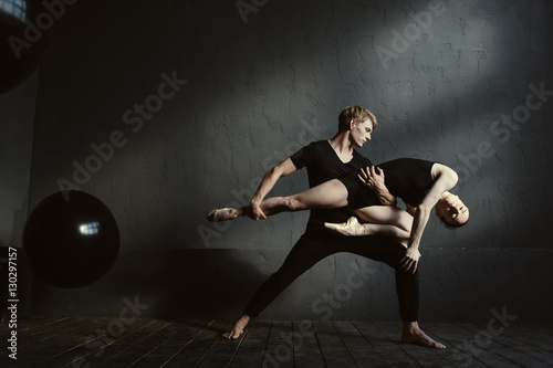 Fototapeta  Slender gymnasts dancing in interaction with each other