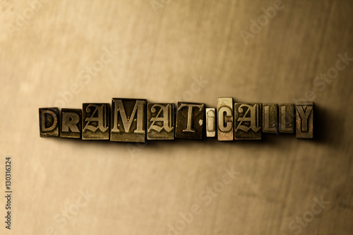 Valokuva DRAMATICALLY - close-up of grungy vintage typeset word on metal backdrop