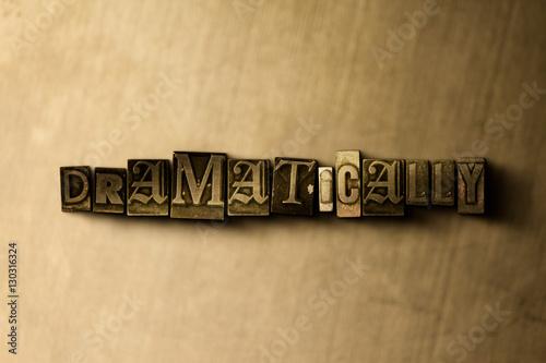 Valokuva  DRAMATICALLY - close-up of grungy vintage typeset word on metal backdrop