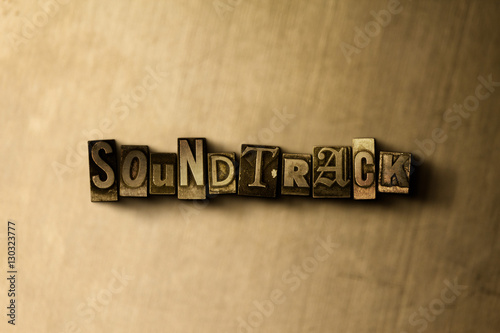 Photo  SOUNDTRACK - close-up of grungy vintage typeset word on metal backdrop