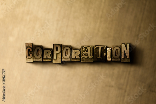 Photo  CORPORATION - close-up of grungy vintage typeset word on metal backdrop
