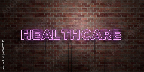 Fototapeta HEALTHCARE - fluorescent Neon tube Sign on brickwork - Front view - 3D rendered royalty free stock picture. Can be used for online banner ads and direct mailers.. obraz na płótnie