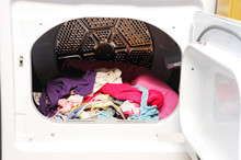 Close Up On Dryer With Clothes...