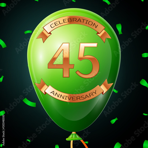 Photographie  Green balloon with golden inscription forty five years anniversary celebration and golden ribbons, confetti on black background