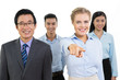 Smiling Business Team and Woman Pointing to Camera