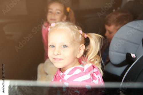 Poster Artist KB Little girl looking through car window