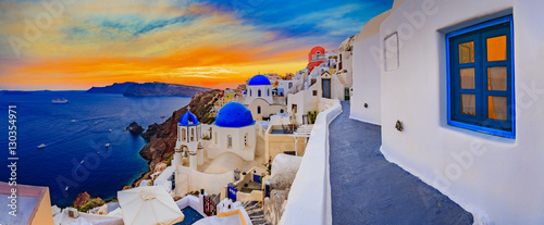 Fototapeta Amazing wide panorama sunset view with white houses on church wi obraz