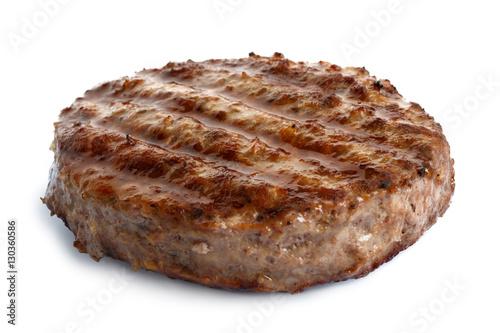 Canvastavla Single grilled hamburger patty isolated on white.