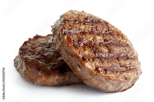 Fotografie, Obraz  Two grilled hamburger patties isolated on white.