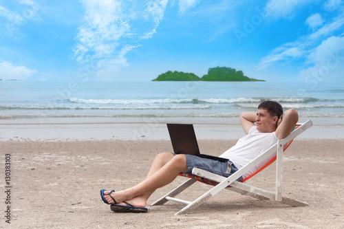 b8526d88df Work of dream in open air. Freelancer man sitting in deck chair on ...